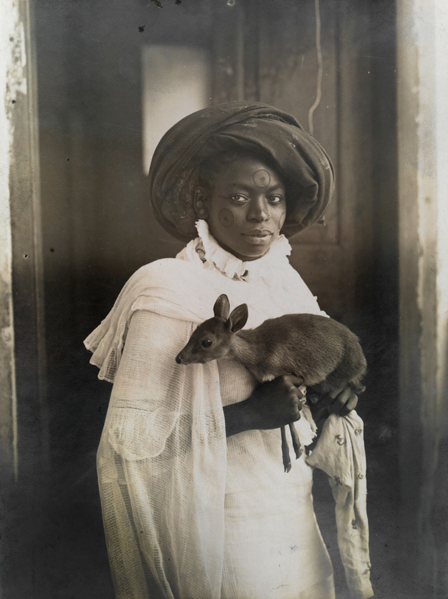 A Young Kenyan Woman Holds Her Pet Deer In Mombassa, March 1909