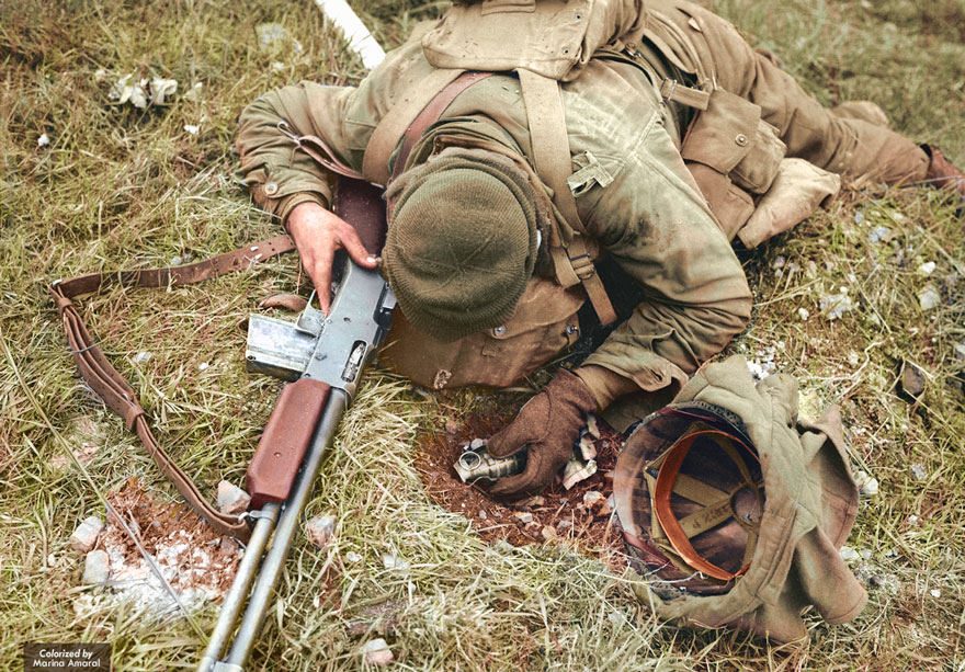 An Unidentified American Soldier, Shot Dead By A German Sniper, Clutches His Rifle And Hand Grenade