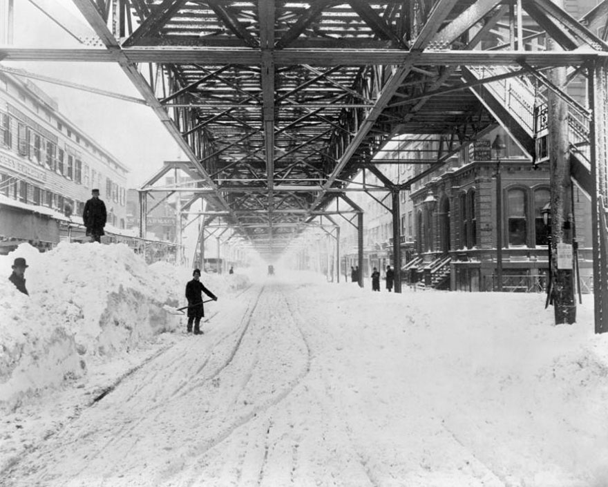 Workers Dig Out The Snow From Underneath An Elevated Train Line After The Blizzard