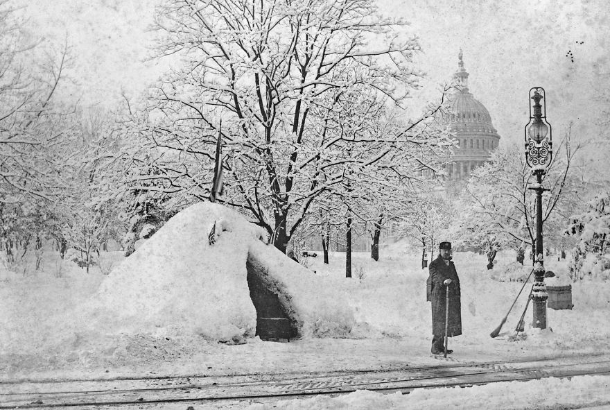 Man Standing By Snow Hut, After Blizzard Of 1888, With U.s. Capitol In Background, Washington