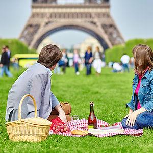 Having A Picnic Near The Eiffel Tower In Paris, France