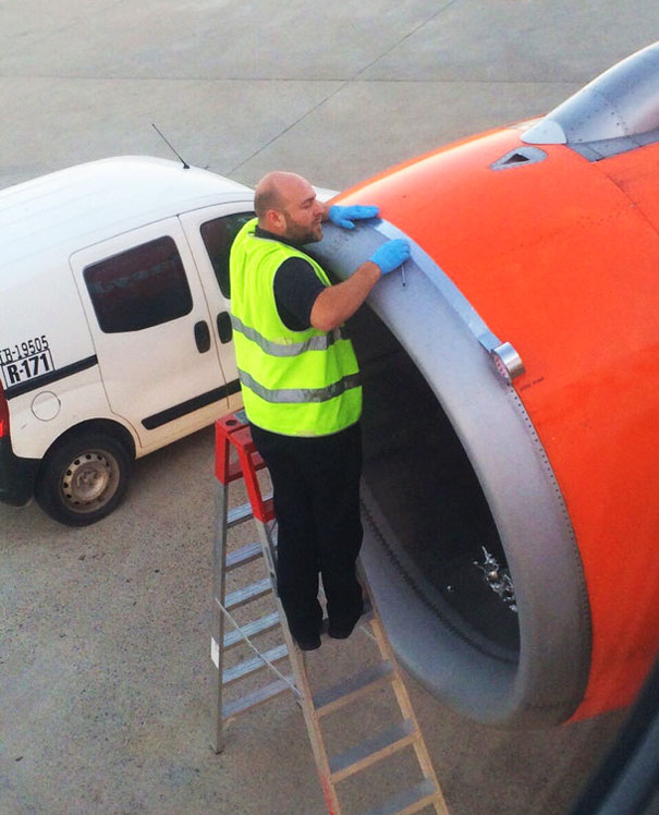 Airplane Passenger Spots Worker Fixing Jet Engine With Tape Before Take-off