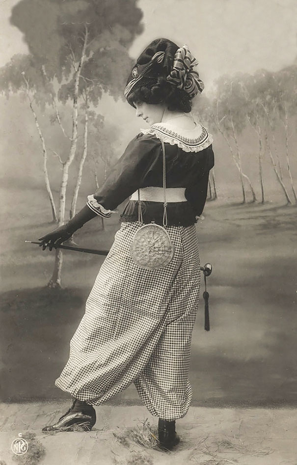 Unknown Lady With Big Hat And Umbrella