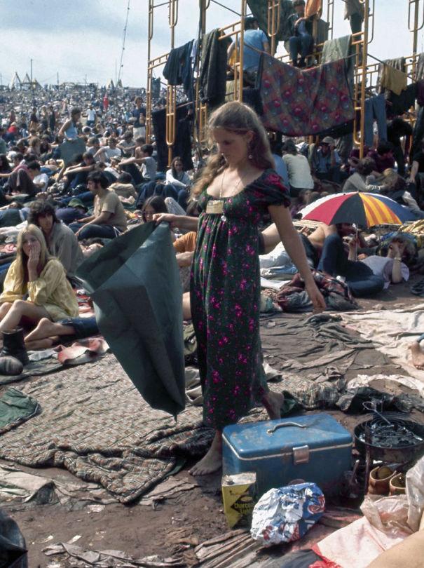 Woman Picks Her Way Barefoot Through Mud And Sleeping Bags