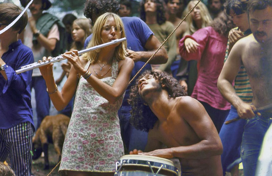 Shirtless Male Drummer & Dress-Wearing Female Flutist Jamming During Woodstock Music Festival