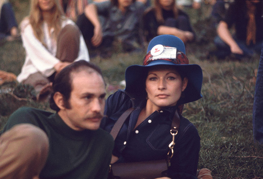 A Man And Woman Lie On The Grass During A Performance On The 'Free Stage' At Woodstock