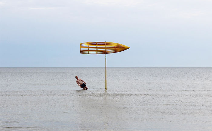 Artist Takes Art Exhibition To Another Level By Placing His Wooden Sculptures Right In The Sea