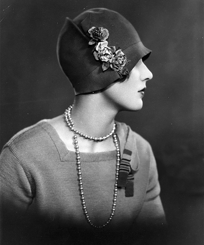 A Woman Wearing A Cloche Hat Decorated With Flowers, 1927