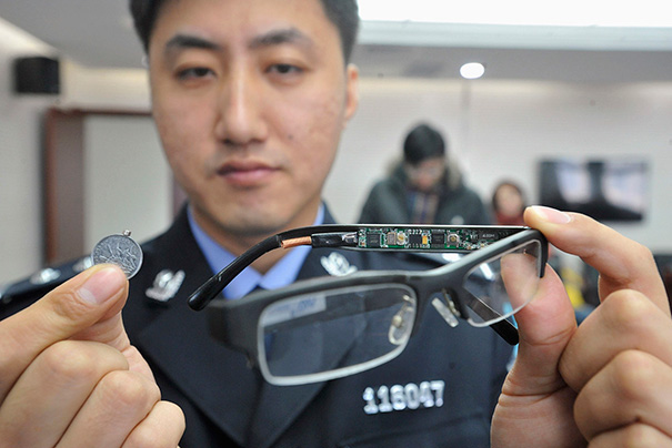 A Pair Of Glasses With A Hidden Camera And A Tiny Receiver Attached To A Coin