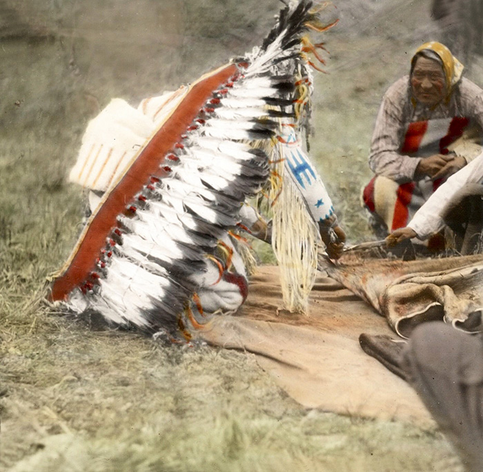 Bear Chief Cutting A Green Hide. Blackfeet. Montana. Early 1900s. Glass Lantern Slide By Walter