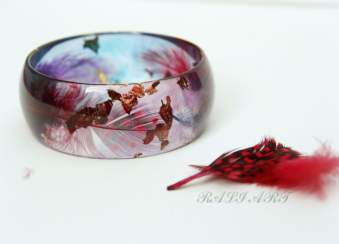 Handmade Jewelry From A Resin And Feathers.