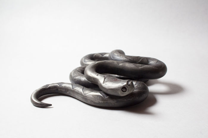 Artist Creates Wrought Iron Snake Sculptures With Etching