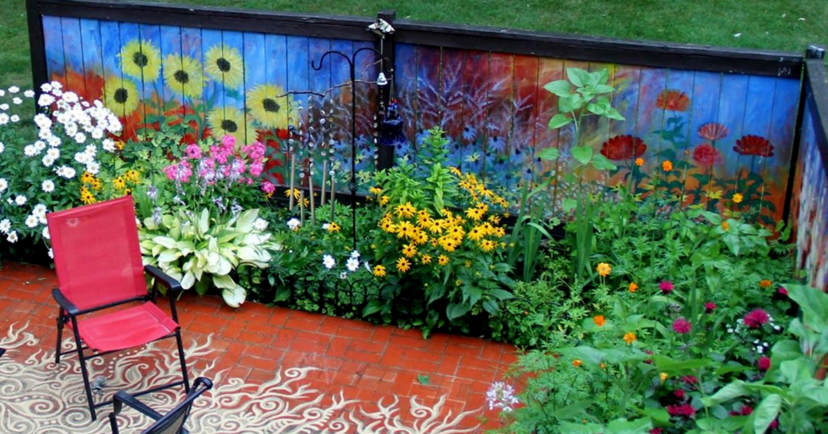 I revived our old garden fence by painting vivid flowers for Garden fence decorations