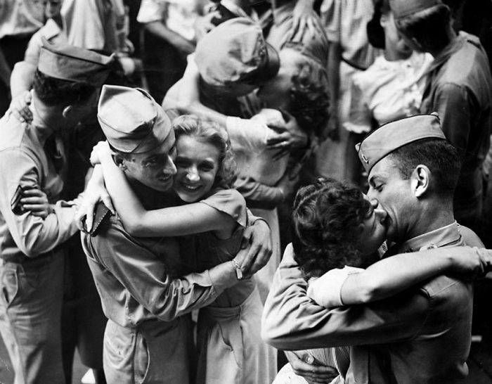 Servicemen And Downtown Workers Embrace And Kiss In The Street As Word Of Surrender Flashed Through The Nation, 1945