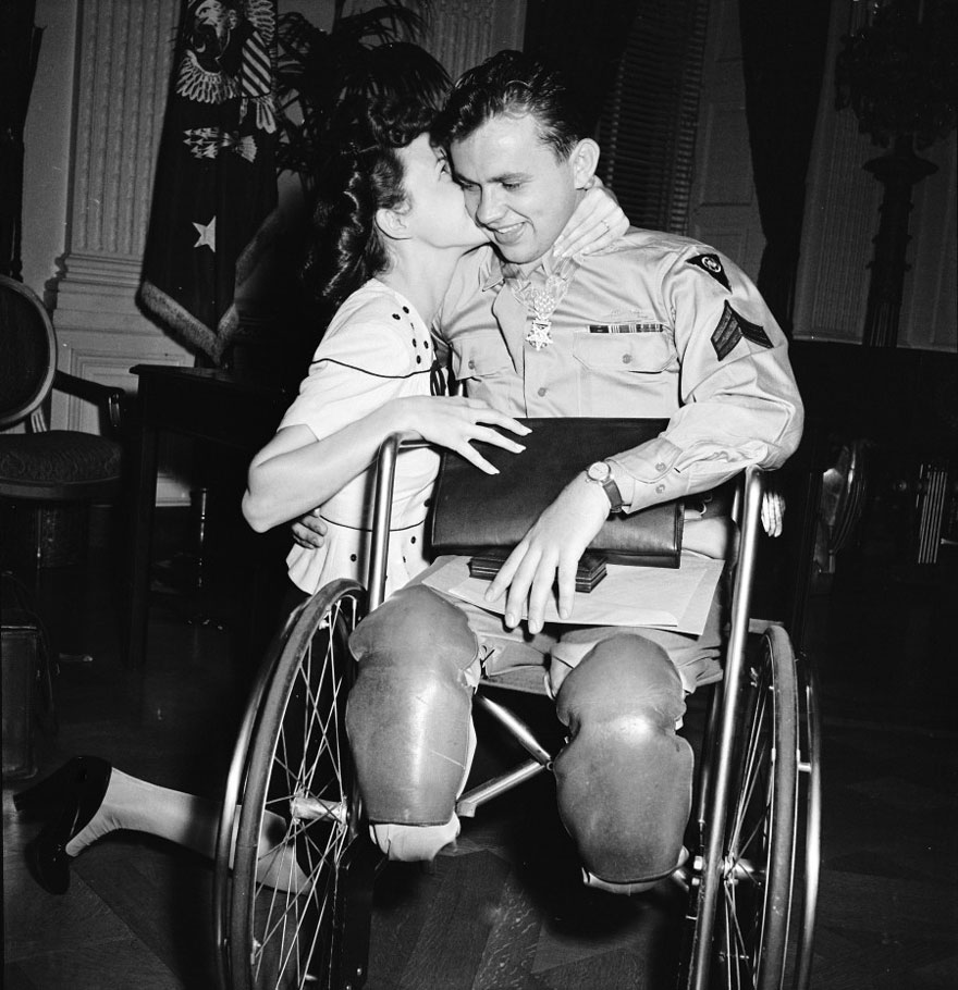 Jean Moore Kneels And Kisses Her Fiancé, Wheelchair-Bound World War II Veteran Ralph Neppel, 1945