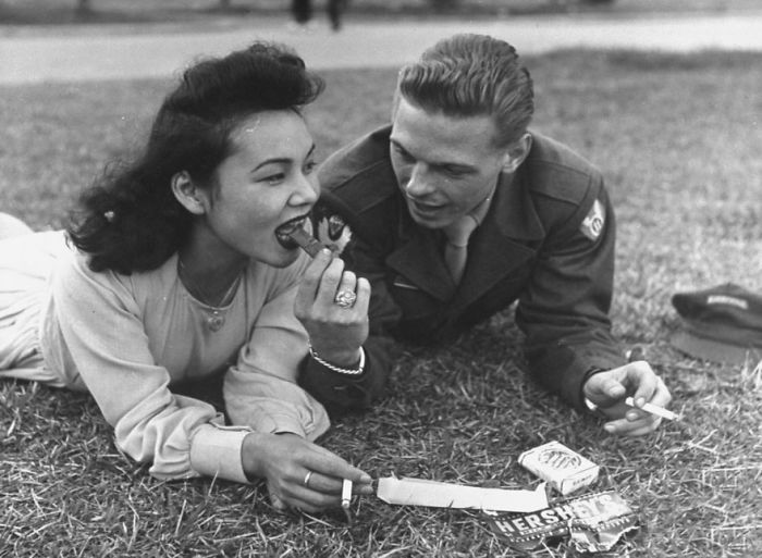 Us Soldier And Local Girl Sharing A Chocolate Bar And Cigarettes, 1940s