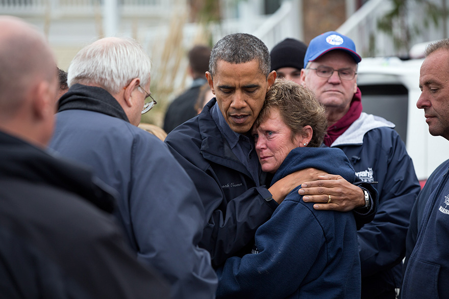 President Barack Obama Hugs Donna Vanzant, The Owner Of North Point Marina, As He Tours Damage From Hurricane Sandy In Brigantine, N.J.