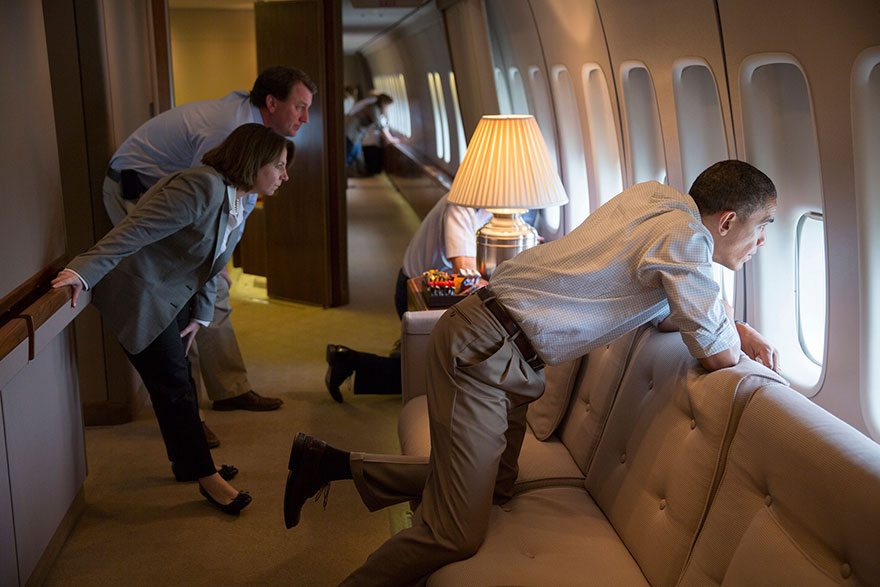 The President And Members Of The White House Staff Look Out The Window Of Air Force One To View Tornado Damage Over Moore, Oklahoma
