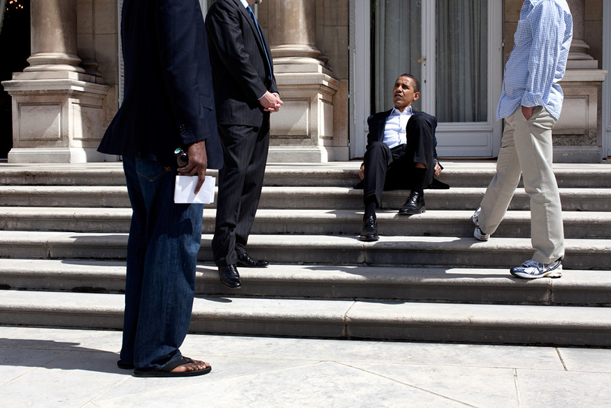 President Barack Obama Talks With Aides Outside The U.S. Ambassador's Residence In Paris Before Returning To Washington