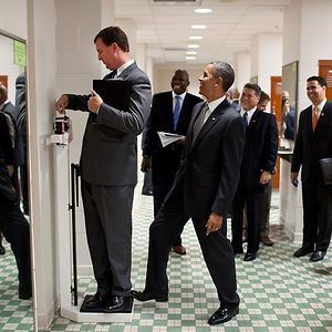 President Barack Obama Jokingly Puts His Toe On The Scale As Trip Director Marvin Nicholson Weighs Himself