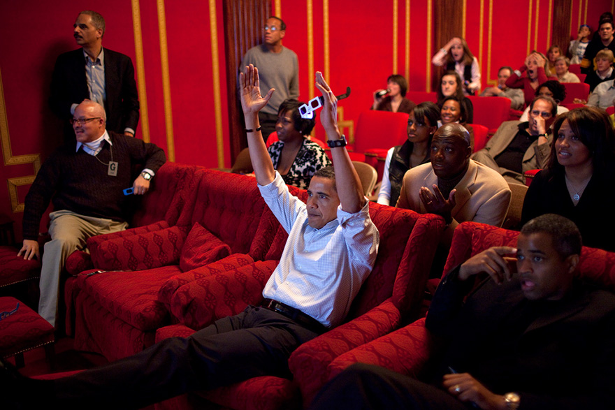 President Barack Obama Holds 3-D Glasses While Watching The Super Bowl Game At A Super Bowl Party