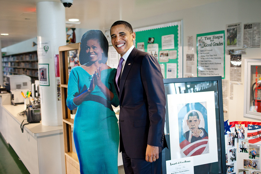 President Barack Obama Stands By A Cut-Out Picture Of First Lady Michelle Obama During A Visit To Miami Central High School