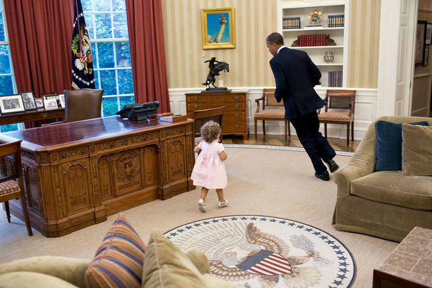 President Barack Obama Runs Around His Desk In The Oval Office With Sarah Froman, Daughter Of Nancy Goodman And Mike Froman, Deputy National Security Advisor For International Economics