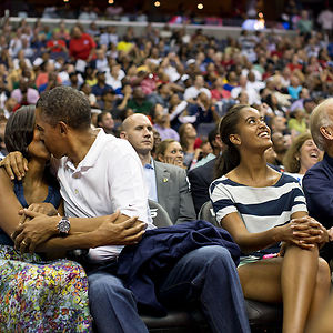 "President Barack Obama Kisses First Lady Michelle Obama For The ""Kiss Cam"""