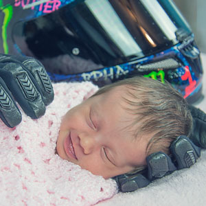 Baby Smiling After Being Wrapped In Her Late Father's Motorcycle Gloves