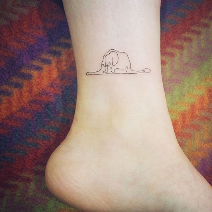 Tiny Foot Tattoo