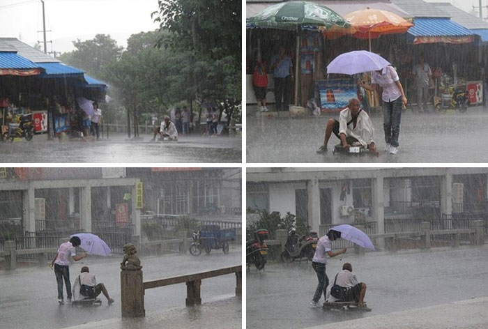 Woman Covering A Soaked Man With Her Umbrella