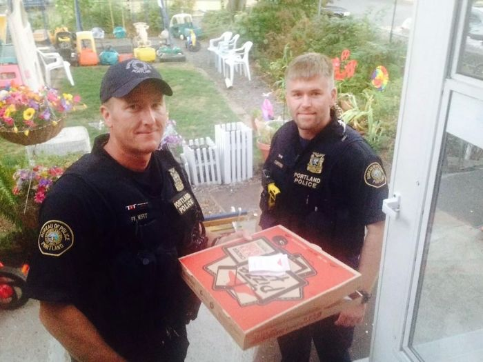Officers Completing Delivery For A Pizza Hut Driver Involved In An Accident