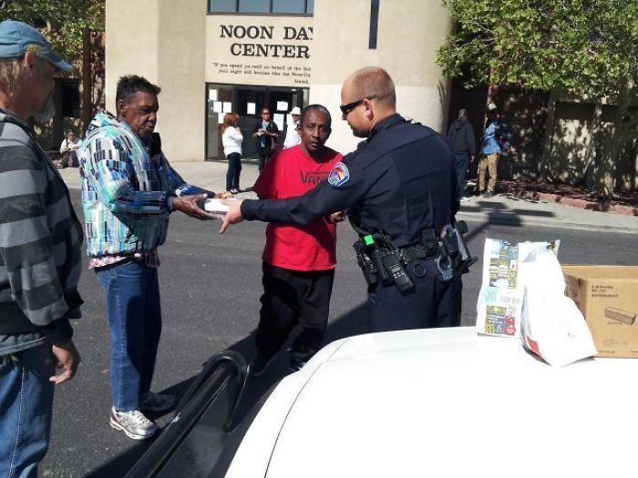 Officer Buying Meals For Homeless People