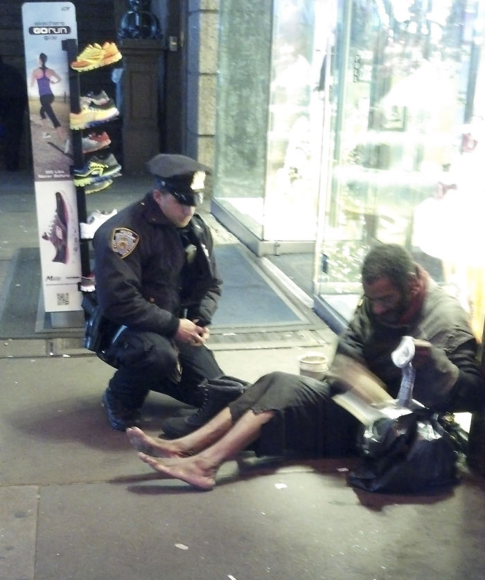 Officer Giving Shoes To A Homeless Man