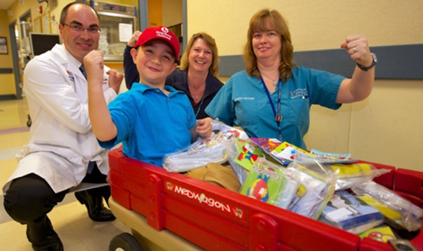After His Treatment And Recovery Rrom The Stomach Flu, Six-Year-Old Jake And His Family Brewed Iced Tea And Baked Cookies, Which They Sold At His Father's Business Asking For Donations Only. They Raised $275, Which Jake Used To Purchase 1,800 Coloring Books To Give To Other Children Who Are Treated At The Hospital