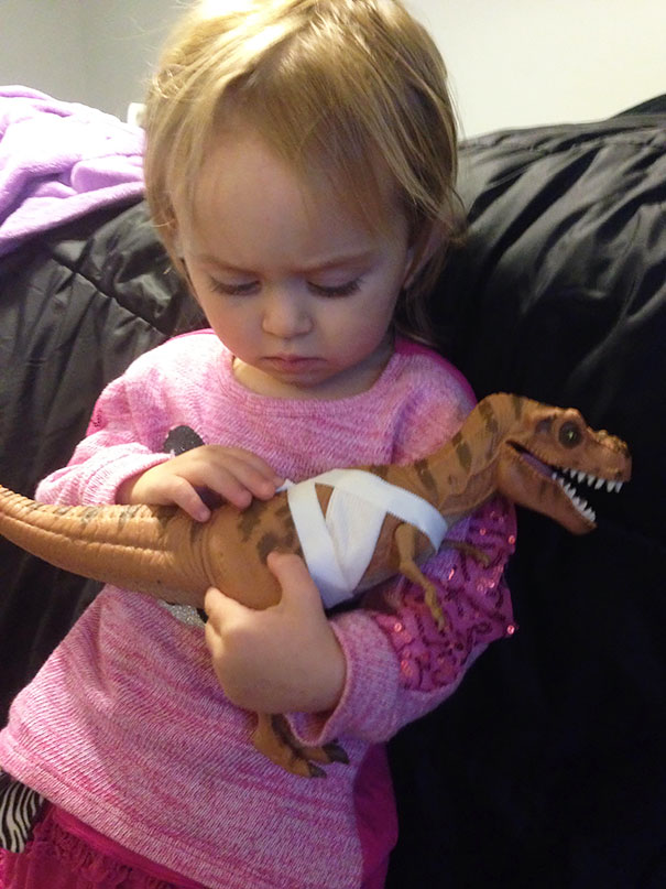 Here's My 2-Year-Old, Who Asked Me To Help Treat This Dinosaur's Wounds, And Now Comforting Him