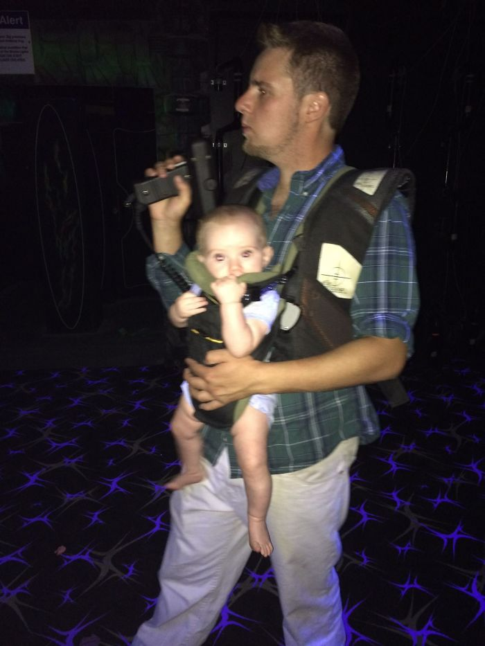Daddy Teaching His Son How To Be A Laser Tag Champ