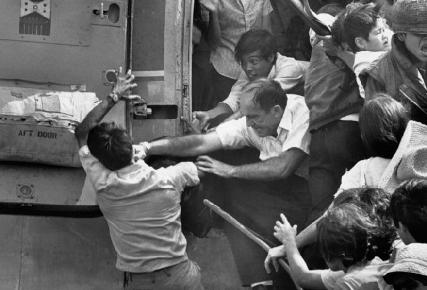 An American Evacuee Punches A South Vietnamese Man For A Place On The Last Chopper Out Of The US Embassy During The Evacuation Of Saigon In 1975