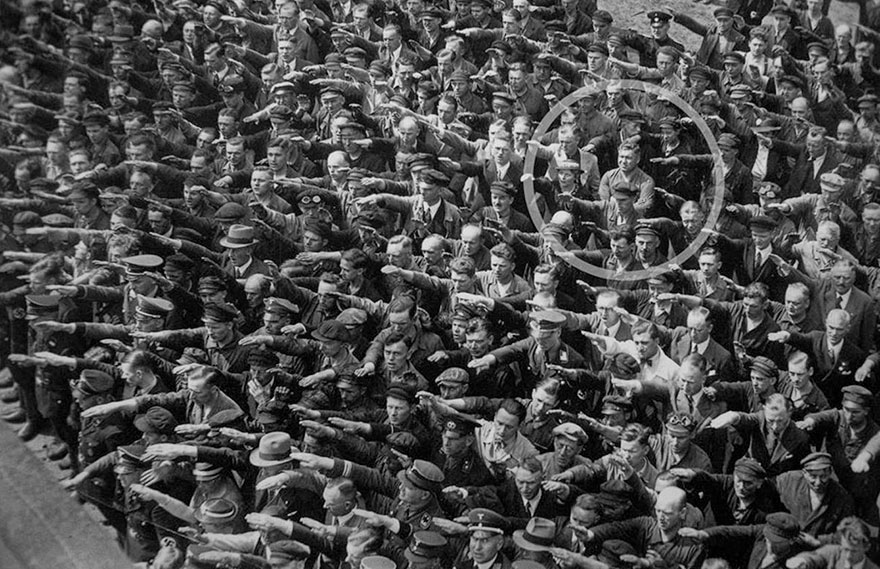 A Lone Man Refusing To Do The Nazi Salute, 1936