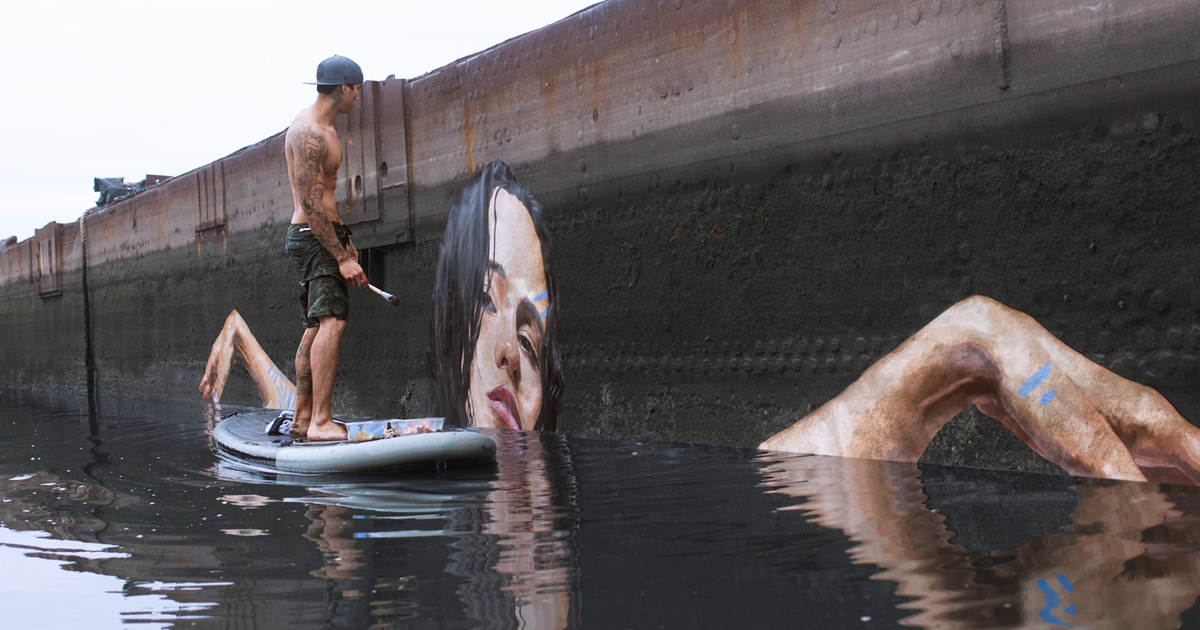 Artist Paints NEW Stunning Seaside Murals While Balancing On A Paddleboard