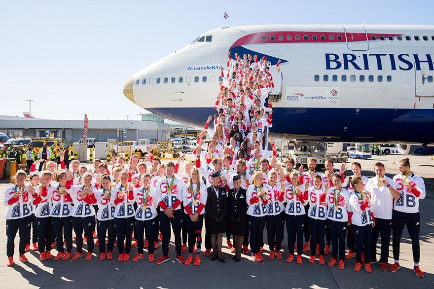british-olympic-athletes-red-bags-heathrow-airport-2