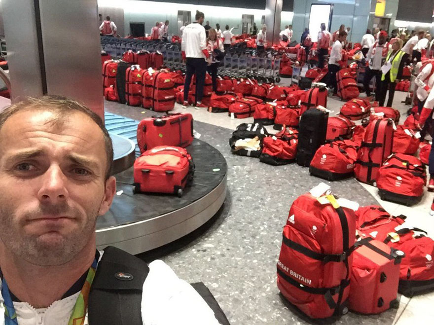 british-olympic-athletes-red-bags-heathrow-airport-6