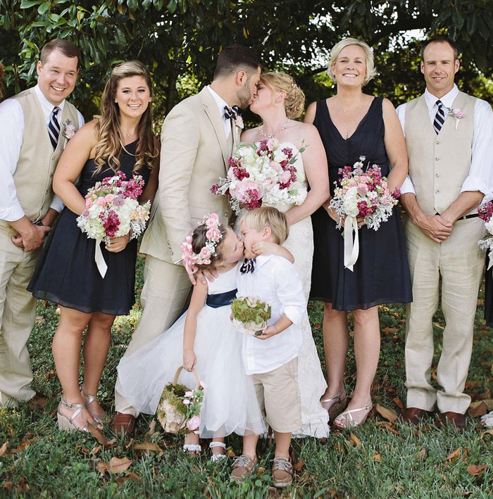 #2 4-Year-Old Flower Girl's Surprise Kiss Steals Spotlight At Mom's Wedding