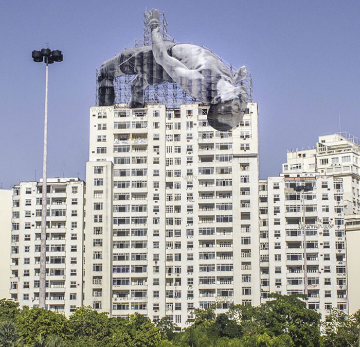 French Artist JR Installs Giant Athletes Across Rio's Urban Landscape For 2016 Olympic Games
