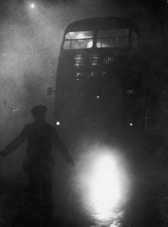 A Bus Conductor Walks In Front Of His Vehicle, 9 December 1952