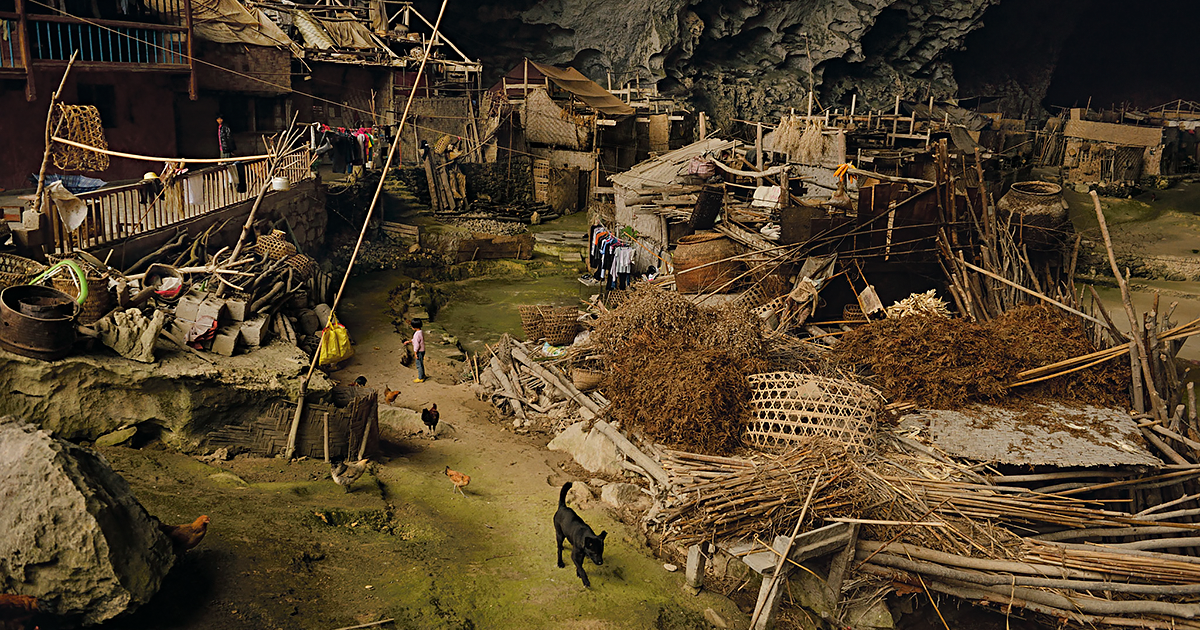 This Giant Cave In China Has 100 People Living Inside, A Basketball Court And Even Had A School