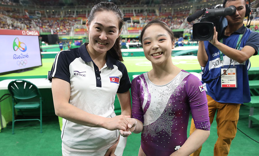 north and south korean olympic gymnasts just took a selfie together and the internet is going
