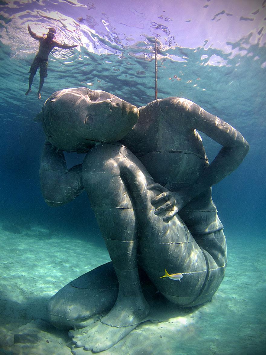 Ocean Atlas: Massive Underwater Statue Of Girl Carrying The Ocean On Her Shoulders