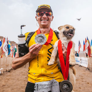 Stray Dog Who Joined Runner On 155-Mile Race Disappears So The Athlete Flies To China To Find Him