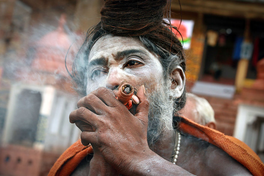 Sâdhu Smoking Shilom On The Banks Of The Ganges, India